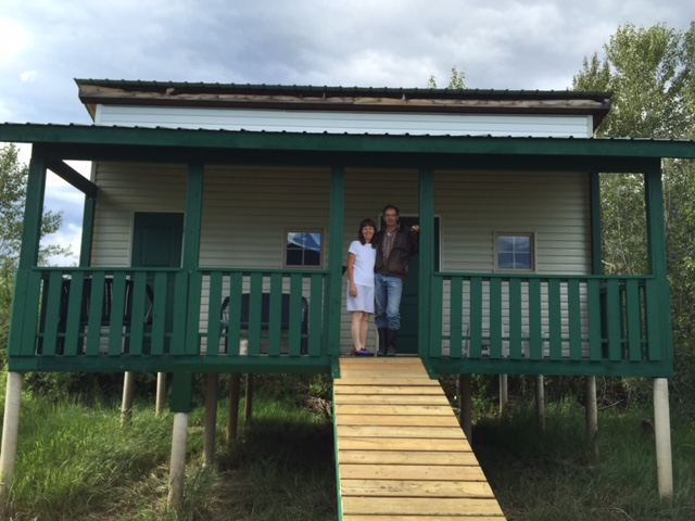 Gary & Karen standing at the entrance of the newly finsished cabin